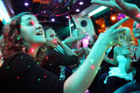 A hen party celebrating on a party bus