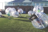 A stag group having fun playing zorb football