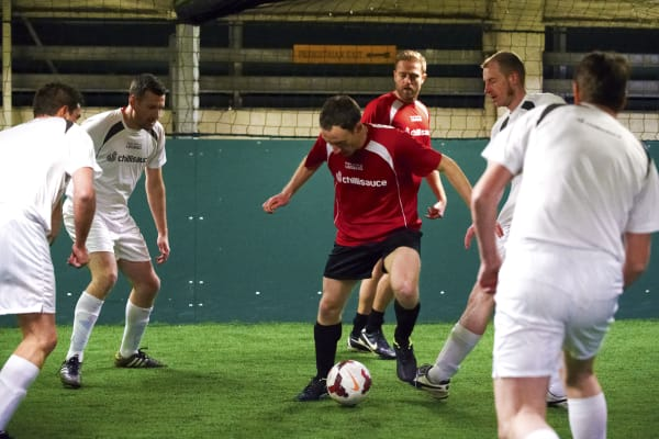 A stag group play five-a-side football