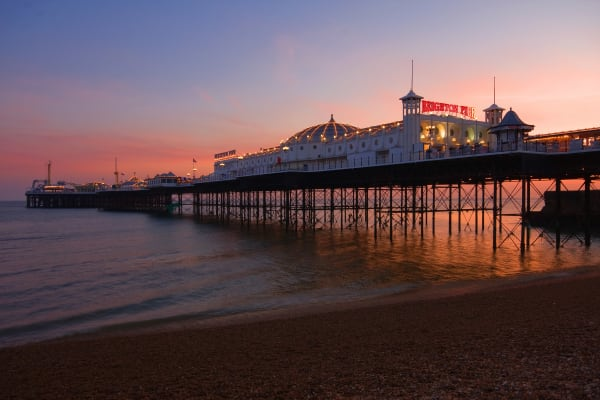 Brighton beach in the evening with the pier