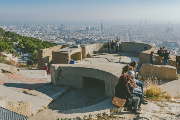*EDITORIAL USE*  People watching panorama of Barcelona form the hill known as the Turo de la Rovira